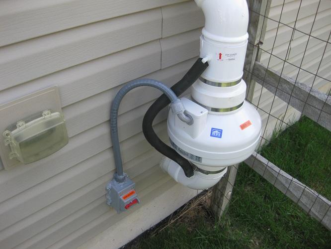 Radon mitigation system fan
